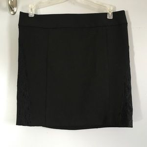 Express black mini skirt with lace on sides.